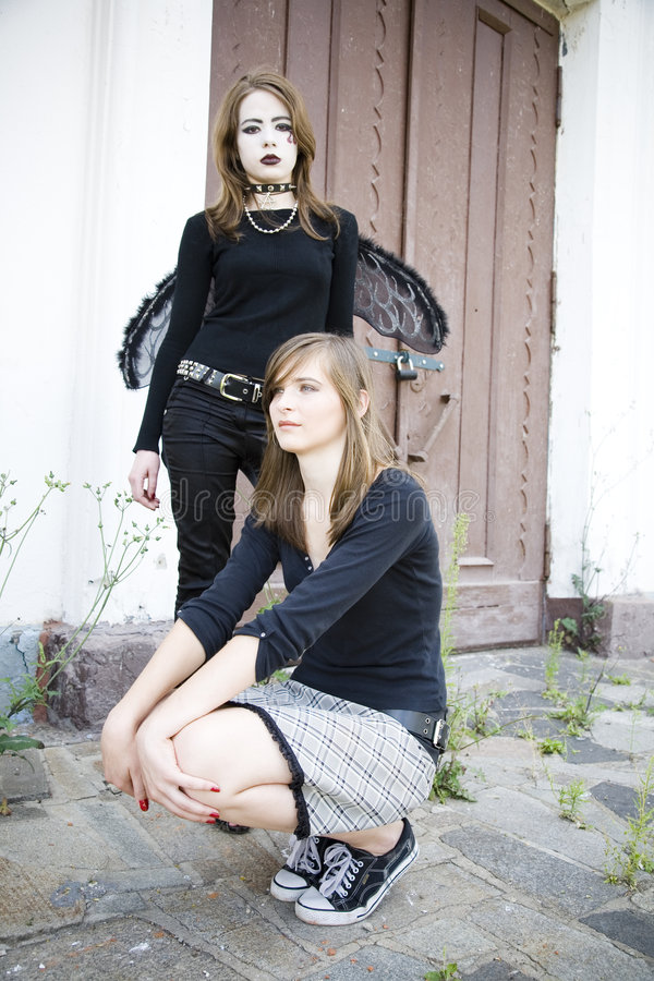 Goth And Pretty Girl royalty free stock photography