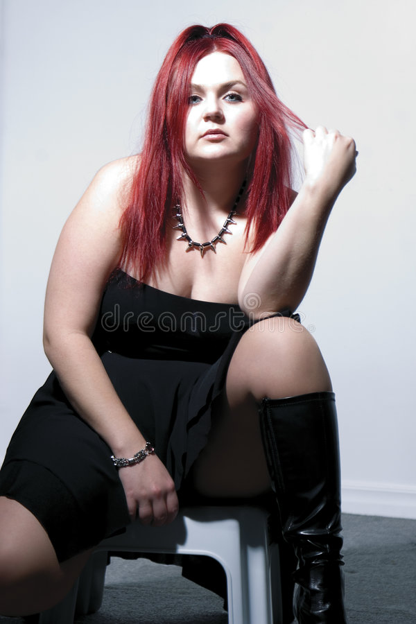 Goth rock red hair chick - High contrast royalty free stock images