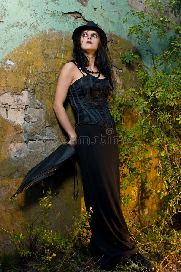 Goth woman leaning on wall royalty free stock photo