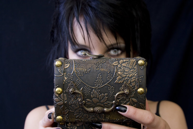 Goth woman's treasure box stock photos