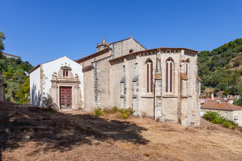 Gothic apse of the Santa Cruz Church with a view of the baroque chapel and portal. stock image