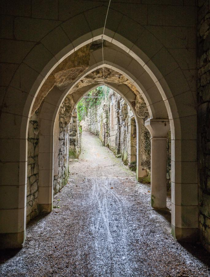Gothic archway in medieval path in Souzay Champigny France. stock image