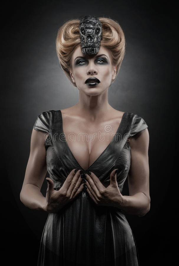 Gothic blond vampiric woman stock image