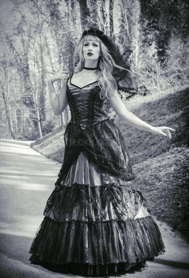 Gothic bride with veil stock photos