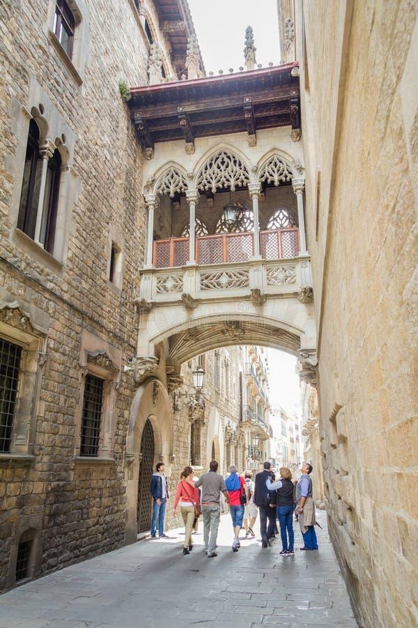 Gothic bridge in Carrer del Bisbe street, in Barcelona, Spain royalty free stock images