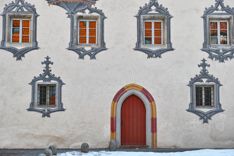 Gothic castle white facade and red door stock image