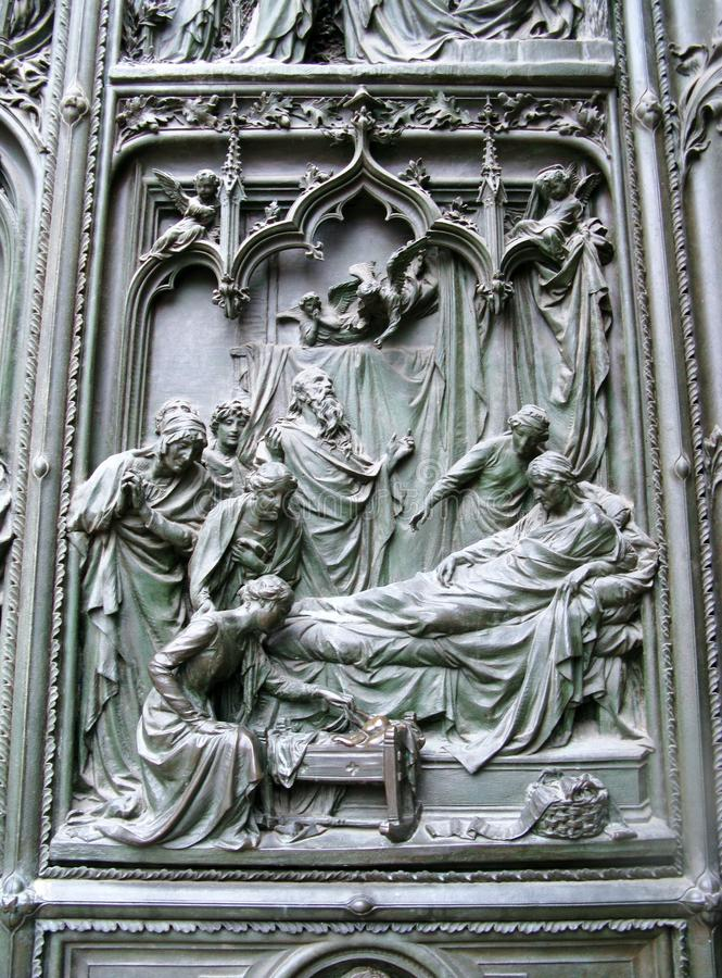 The gothic cathedral of Milan in Italy. A detail of the sculptural decorations of the gothic cathedral of Milan in Italy royalty free stock photo