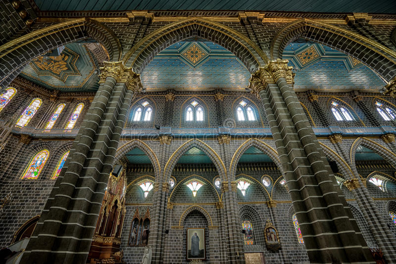 Gothic church interior. Interior gothic architectural details of the Immaculate Concepcion basilica in El Jardin Colombia stock photos