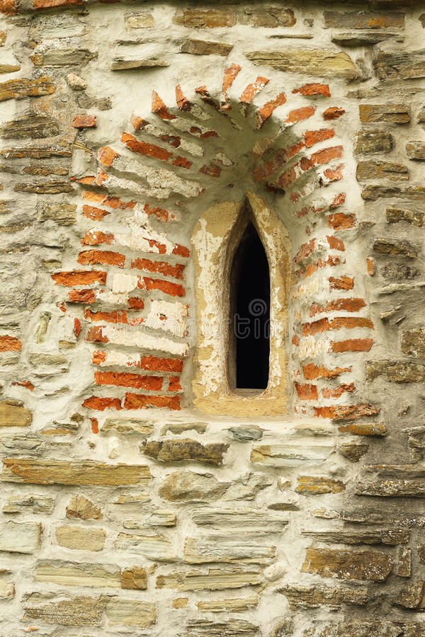 Gothic church window detail. On old abandoned historical building stock images