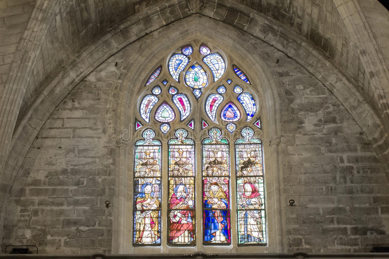 Gothic colorful mosaic window in church. Colorful gothic mosaic window in church stock photo