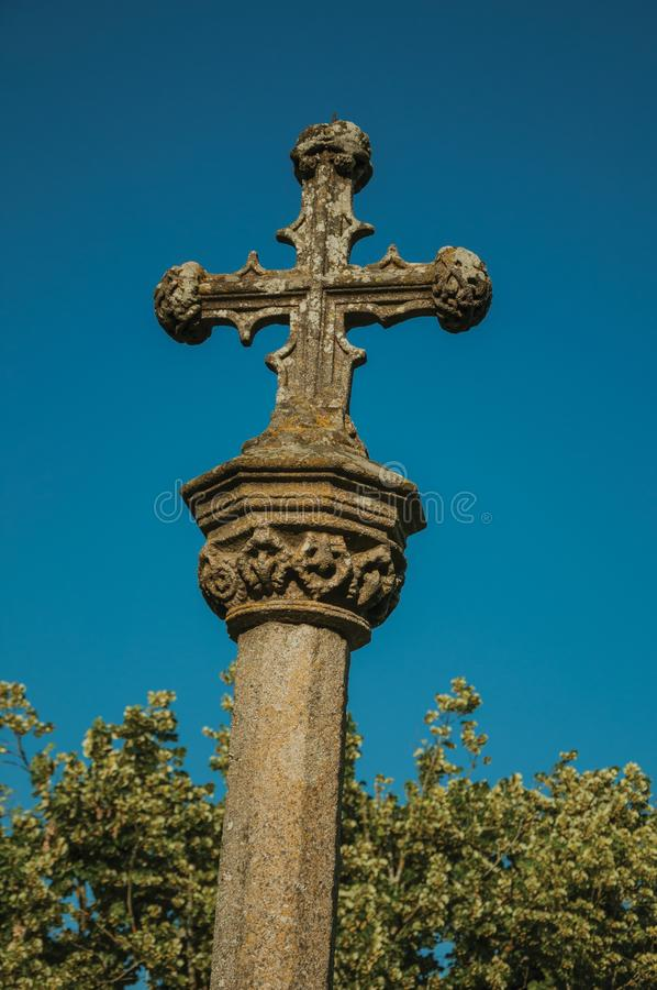 Gothic cross carved in stone on top of a pillory stock image