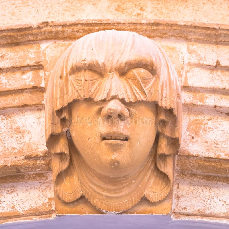 Young Woman Gothic Portrait. Gothic detail. Young woman portrait at the entrance of a 200 years old building in Ciutadella town, Menorca Spain stock images