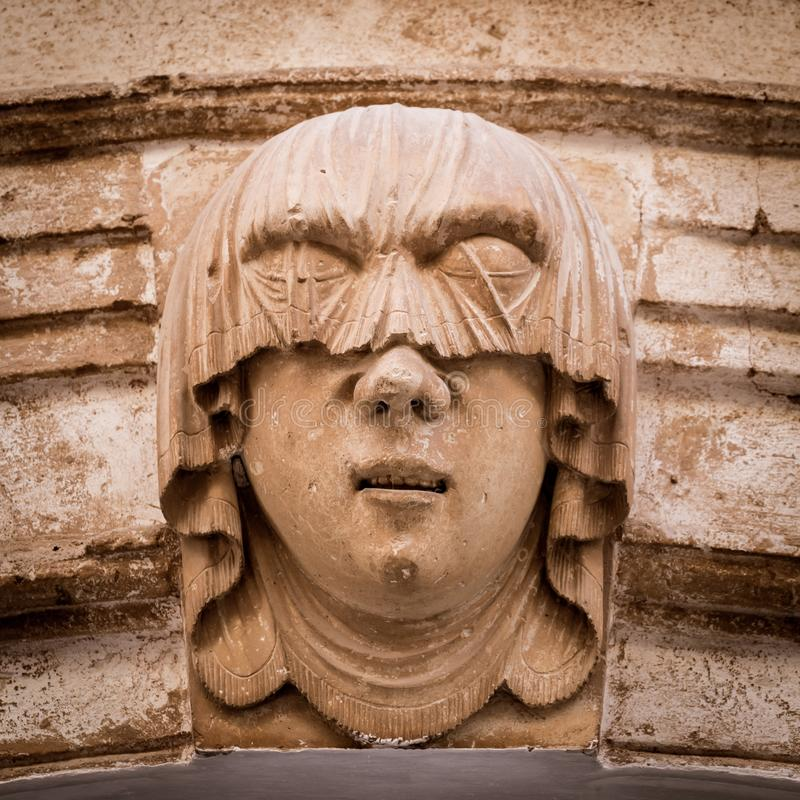 Young Woman Gothic Portrait. Gothic detail. Young woman portrait at the entrance of a 200 years old building in Ciutadella town, Menorca Spain royalty free stock photo