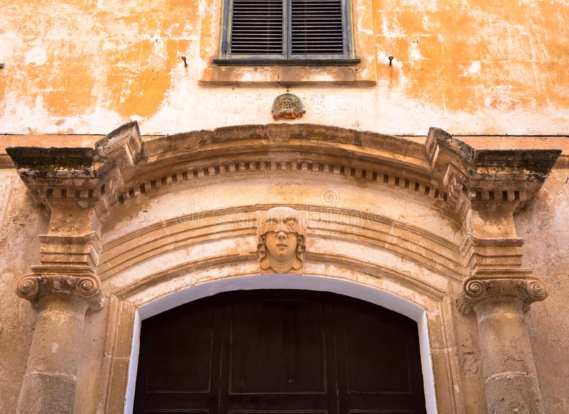 Young Woman Gothic Portrait. Gothic detail. Young woman portrait at the entrance of a 200 years old building in Ciutadella town, Menorca Spain stock photos