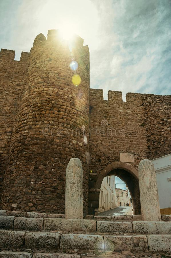 Gothic door called Sun Gateway on sunshine at Estremoz. Gothic door in the stone outer wall called Sun Gateway, on sunshine at the Castle of Estremoz. A nice stock images