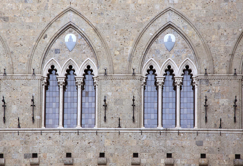 Gothic double windows. At a palace in Siena in Tuscany, Italy stock photography