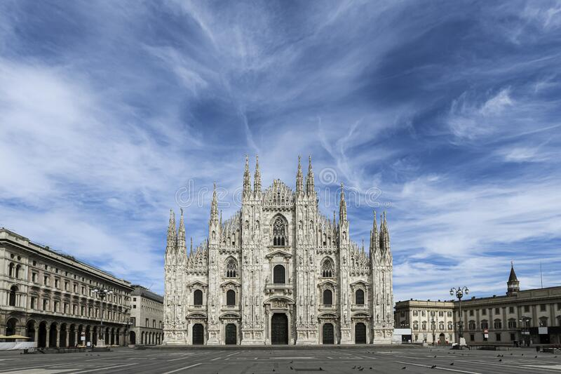 The gothic Duomo Cathedral facade in Milan, Italy on a beautiful spring day. stock photo