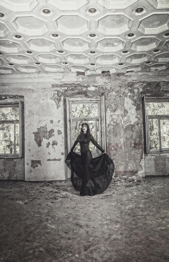 Gothic girl in a beautiful black dress stock images