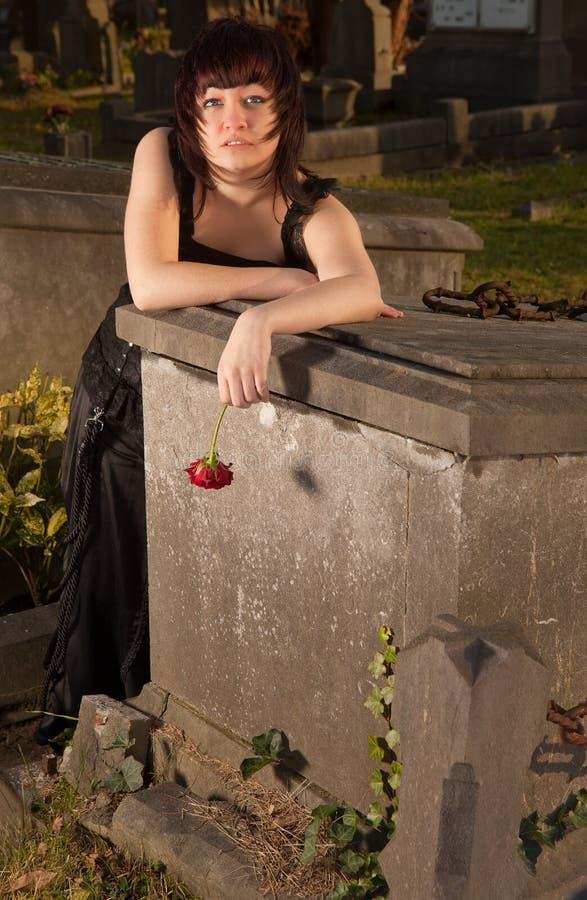 Gothic girl in graveyard stock image