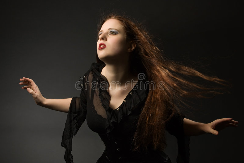 Gothic girl in the wind stock photo