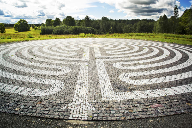 Gothic labyrinth from black and white cobble-stones royalty free stock photography