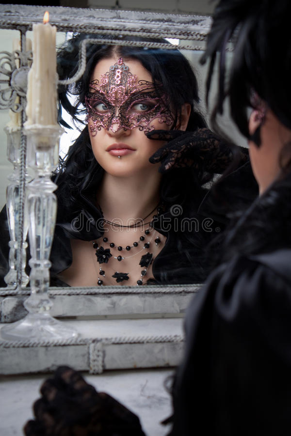 Gothic lady at mirror stock photography