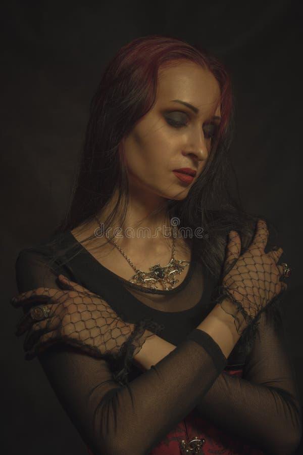 Gothic lady. Posing over black background stock image