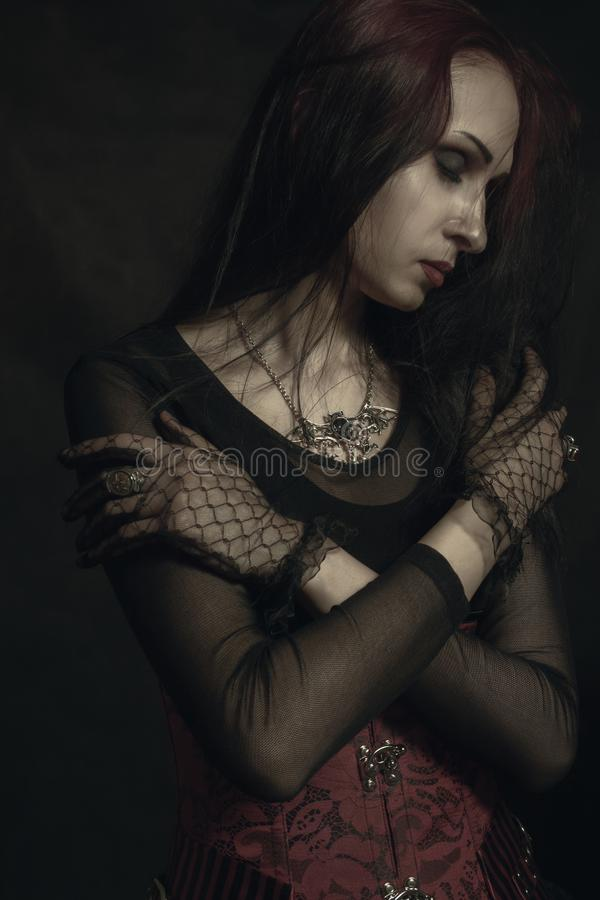 Gothic lady. Posing over black background royalty free stock photo