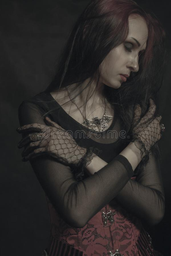 Gothic lady. Posing over black background royalty free stock images