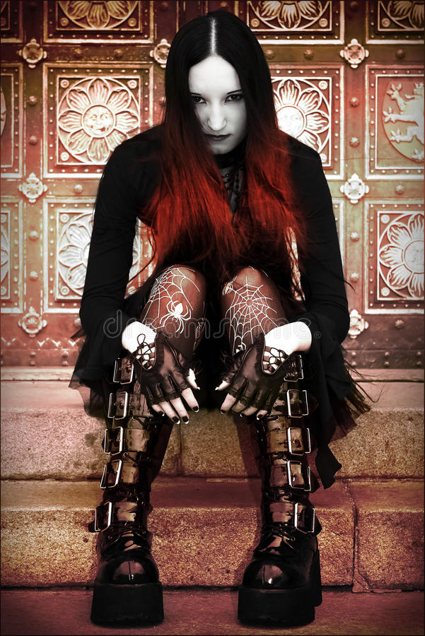 Gothic lady on stairs royalty free stock photography