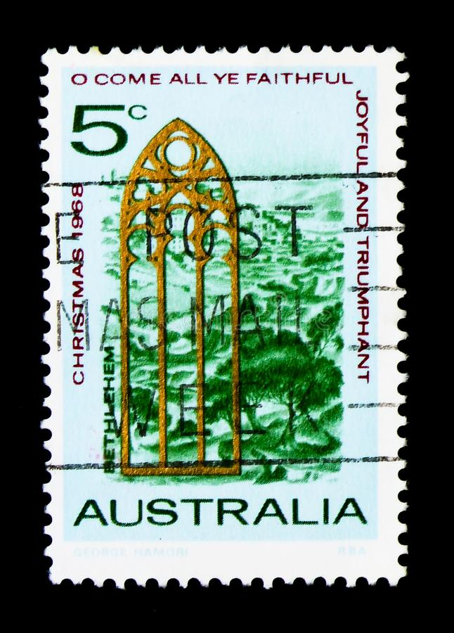 Gothic lancet window in front of the landscape of Bethlehem, Christmas 1968 serie, circa 1968. MOSCOW, RUSSIA - MARCH 28, 2018: A stamp printed in Australia stock images