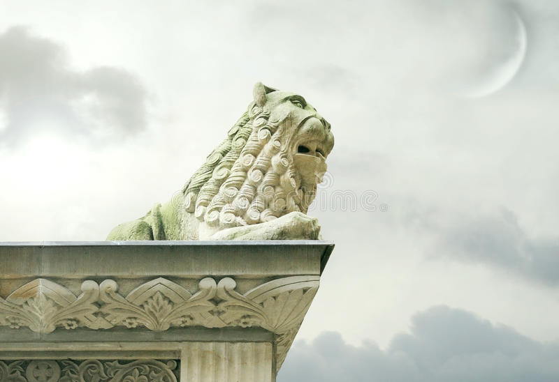 Gothic lion sculpture on the ledge of the roof stock photo