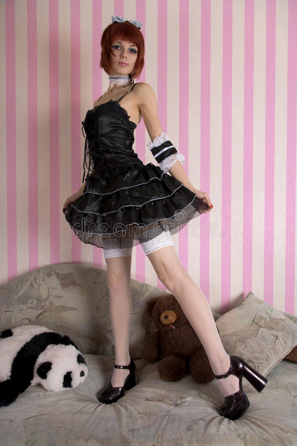 Gothic Lolita girl in funny interior stock images