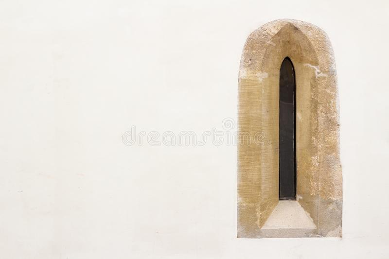 Gothic narrow window on white wall. With copy space stock images