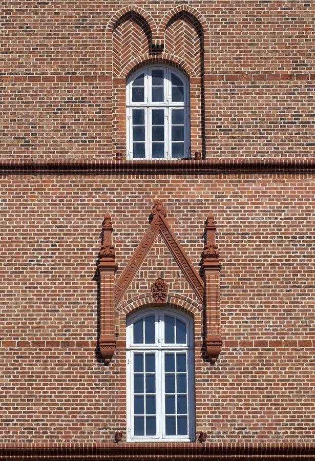 Gothic Ornamentation. Two practical windows are made more interesting by Gothic ornamentation and brickwork royalty free stock photo