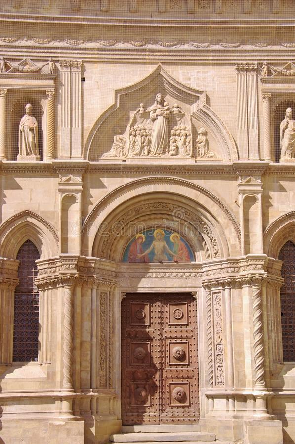 The gothic palace of the lay fraternity in Arezzo in Italy. Detail of the entrance of the gothic palace of the lay fraternity in Arezzo in Tuscany in Italy stock photos