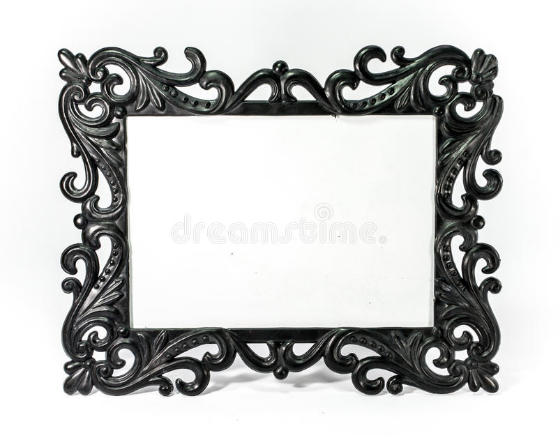 Gothic picture frame. Black gothic style of picture frame on white scene,shallow focus stock photos