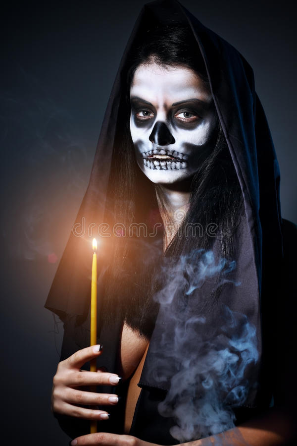 Gothic portrait of dead woman. With candle royalty free stock photo