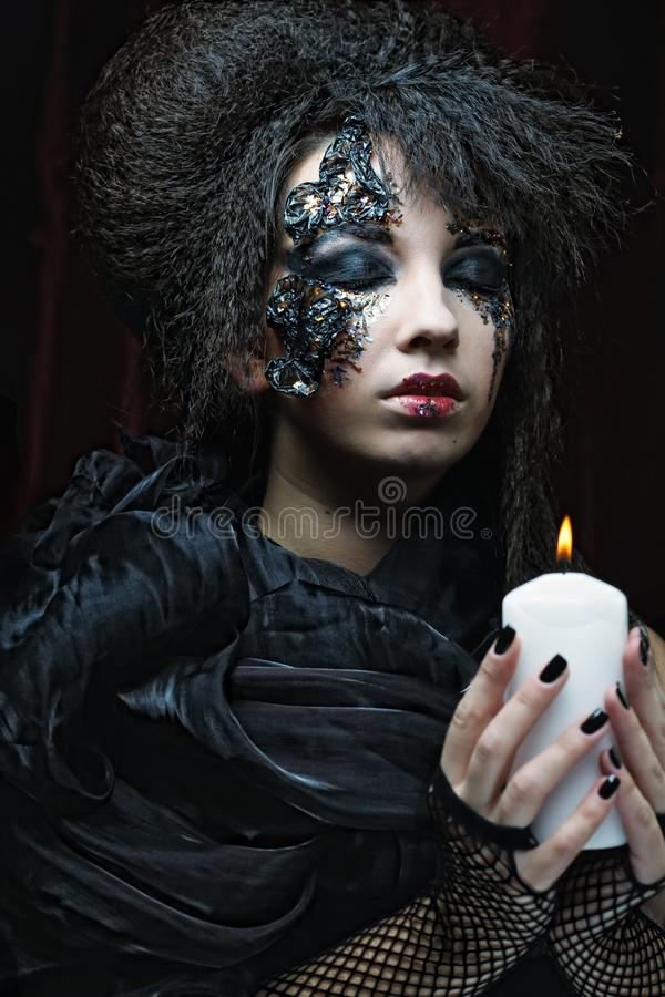 Gothic portrait of woman with candle. Halloween theme stock images