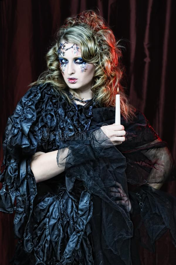 Gothic portrait of woman with candle. Halloween theme royalty free stock photos