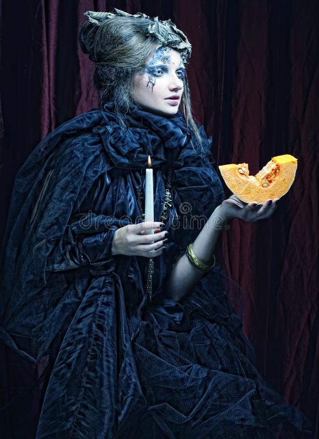 Gothic portrait of woman with candle. Halloween theme royalty free stock photo