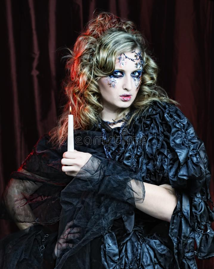 Gothic portrait of woman with candle. Halloween theme royalty free stock image