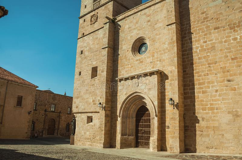 The gothic Santa Maria Cathedral facade and old buildings at Caceres stock photography
