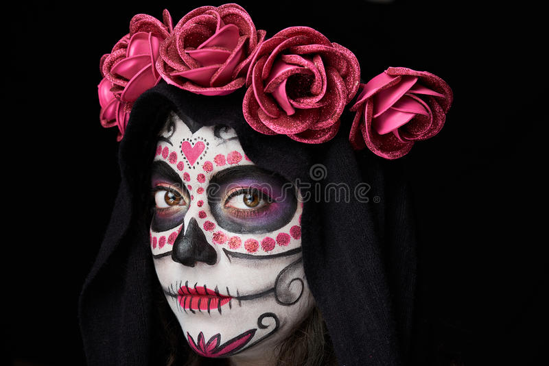 Gothic skull portrait. Of woman with flowers and mantle on black royalty free stock photos