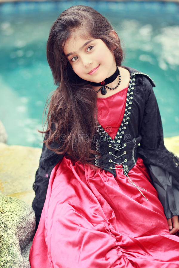 Gothic style. Little girl dressed in a costume for halloween stock photos