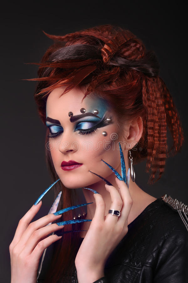 Gothic style shot of a woman with claw rings with eyes closed.  royalty free stock photos