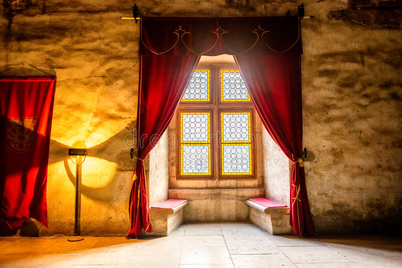 Gothic style window alcove. A Gothic-Renaissance style alcove with seats and stained glass window royalty free stock photography