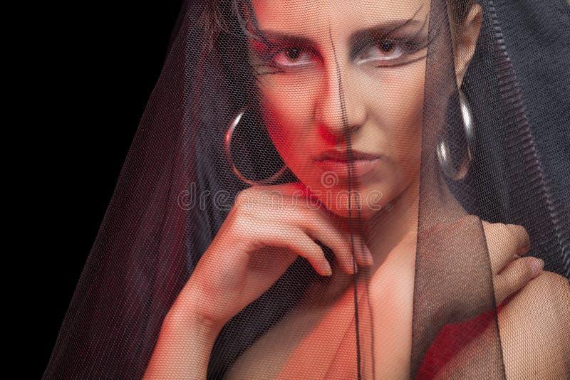 Gothic style woman on black background. Professional art fashion make up. Dark bride stock image