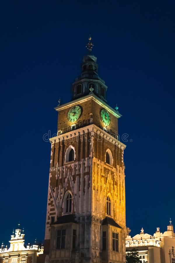 Gothic town hall tower with clock in Cracow, Poland. Summer night scene 2019 Wieża Ratuszowa Krakow attractions, central square. Vertical photo stock image