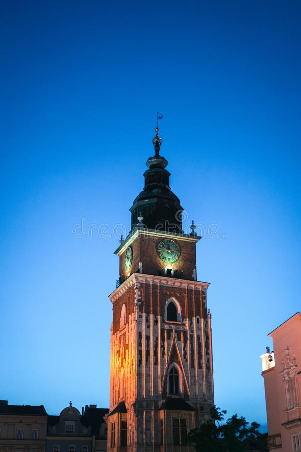 Gothic town hall tower with clock in Cracow, Poland. Summer night scene 2019 Wieża Ratuszowa Krakow attractions, central square. Vertical photo stock photos